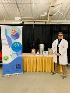 Deuterium scientist at a display booth for exhibiting career opportunities for Isowater Deuterium Oxide Supply and Delivery