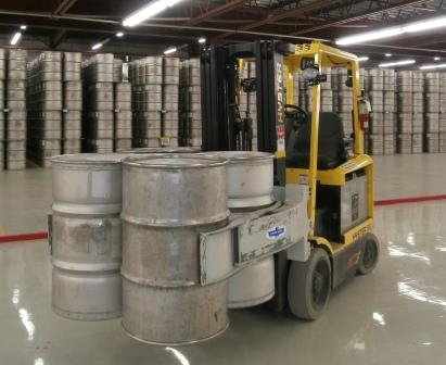 A picture of a forklift carrying a skid of heavy water barrels