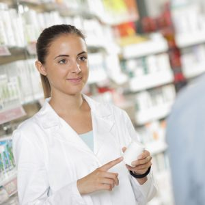 A pharmacist discussing the benefits of deuterium in the pharmaceutical industry