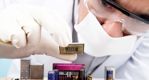 Scientist installing a CPU. Technology is one of the many applications for deuterium oxide